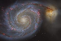 The Whirlpool Galaxy and its companion galaxy. Stock Photos