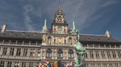 CLOSE UP: Amazing fountain statue Brabo in front of richly decorated City Hall Stock Footage