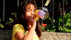 Girl Making Soap Bubble Stock Footage
