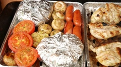 Grilling of steak, pepper, garlic, tomatoes ,  sausages in aluminum case Stock Footage