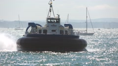 A passenger carrying hovercraft approaches the shore. Stock Footage