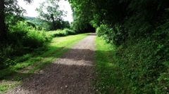 Smooth motion along an english countryside walkway and bridlepath Stock Footage