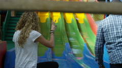 4K Parents waiting for their children at bottom of slide in indoor playground Stock Footage