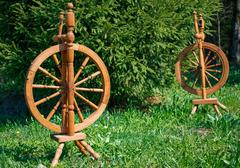 Old wooden spinning swirling amid the green park - stock photo