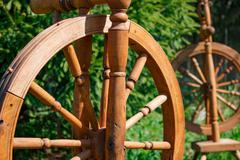 Old wooden spinning swirling amid the green park Stock Photos