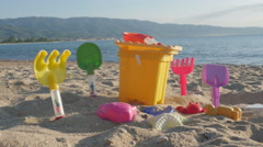 Toys for game close up, seascape with sandy beach and sea water in background. Stock Footage