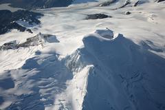 Aerial view of glaciated Mount Douglas volcano, Alaskan Peninsula. - stock photo