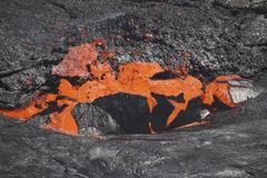 Lava breaking through crust of lava lake, Erta Ale volcano, Danakil Depression, - stock photo
