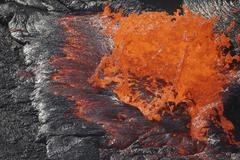 Lava bursting at edge of active lava lake, Erta Ale volcano, Danakil Depression, Kuvituskuvat