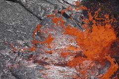 Lava bubble bursting through crust of active lava lake, Erta Ale volcano, - stock photo