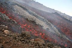 Lava flow during eruption of Mount Etna volcano, Sicily, Italy. Kuvituskuvat