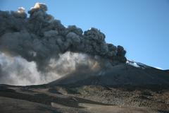 Ash clouds erupting from crater during eruption of Mount Etna volcano, Sicily, Kuvituskuvat