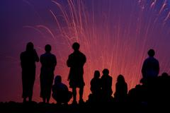 Tourists observing the Strombolian eruption of Yasur Volcano, Tanna Island, Stock Photos