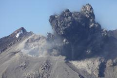 Ash cloud following explosive Vulcanian eruption, Sakurajima Volcano, Japan. Stock Photos