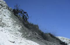 Natrocarbonatite lava flow from flank of hornito at Ol Doinyo Lengai volcano, - stock photo