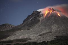 Glowing lava dome during eruption of Soufriere Hills volcano, Montserrat, Kuvituskuvat