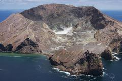 Aerial view of White Island volcano with central acidic crater lake, Bay of Stock Photos
