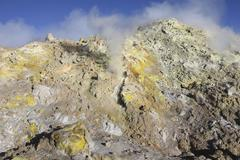Fumaroles with sulphur deposits. Flank of Bocca Nuova crater, Mount Etna - stock photo