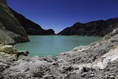 Acidic crater lake on Kawah Ijen Volcano, Java, Indonesia. Stock Photos