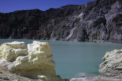 Acidic crater lake on Kawah Ijen Volcano, Java, Indonesia. Stock Photos