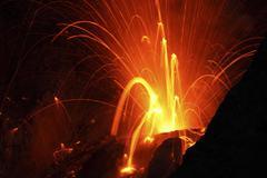 Strombolian type eruption of Batu Tara volcano, Indonesia. - stock photo
