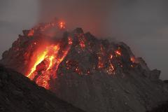 Glowing Rerombola lava dome of Paluweh volcano, Indonesia. Stock Photos