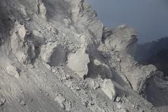 Extrusion lobes on flank of Rerombola lava dome of Paluweh volcano. - stock photo