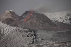 Incandescent rockfall of glowing lava down flank of Shiveluch Volcano. - stock photo