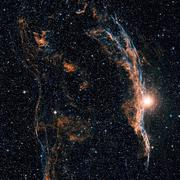 The Witch's Broom Nebula (NGC 6960), and part of the Veil Nebula - stock photo