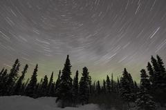 Star Trails, Milky Way and Green Aurora. Stock Photos
