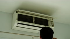 Technicians are using a vacuum cleaner to clean the air conditioner. Stock Footage