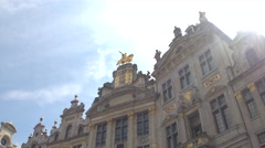 CLOSE UP: Amazing gold decorated guildhall facade and stunning horseman statue Stock Footage