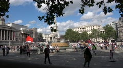 Visitors Enjoying the hot Sunshine in Trafalgar Square London Stock Footage