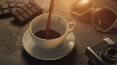 Cup of hot chocolate with retro camera and sunglasses Stock Footage