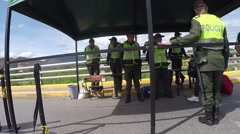 Pan of security tent on bridge with police watching people pass (HD) Stock Footage