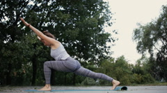 Yoga exercise. Woman practicing on the street. Stock Footage