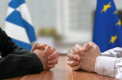 Negotiation of Greece and European Union. Statesman or politicians with clasp - stock photo