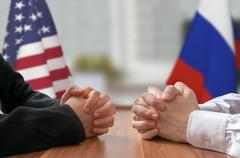 Negotiation of USA and Russia. Statesman or politicians with clasped hands. Stock Photos