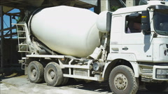 The Cement mixer truck during loading Stock Footage