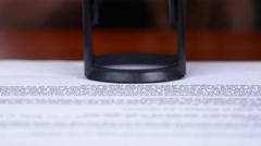 Woman puts a stamp on the document. Close up Stock Footage