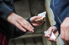Close up of addict buying dose from drug dealer Stock Photos
