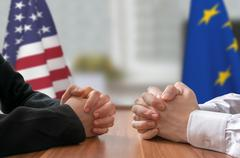 Negotiation of USA and European Union. Statesman or politicians with clasped  Stock Photos
