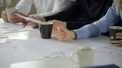 A group of people sitting at confer table in office, woman makes notes with Stock Footage