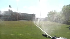 Big Sprinkler Watering Football Field Stock Footage