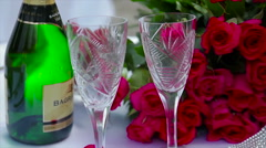 Red roses glass champagne on table Arkistovideo