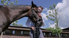 The man petting the horse on the nature - stock footage