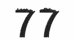 Ornamental number 77 formed of black spheres Stock Footage