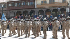 Soldiers marching past cathedral of cusco in peru Stock Footage