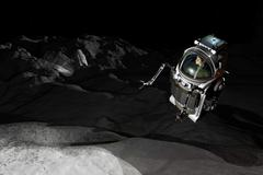 Two Manned Maneuvering Vehicles explore the airless, microgravity environment of Stock Illustration