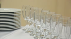Glass wine glasses or champagne standing on table with a white cloth with Stock Footage